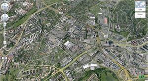 Skjermdumpfaksimile av Google Earth over Løren. Legg merke til den svært tette klynga litt over midten i bildet. Bildet lenker til Google Earth.